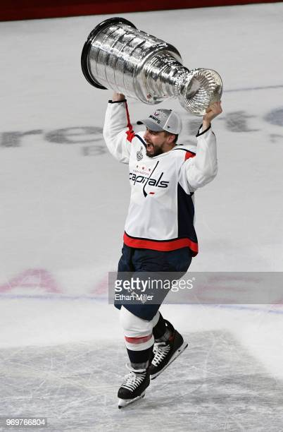 Matt Niskanen of the Washington Capitals hoists the Stanley Cup after the team's 43 win over the Vegas Golden Knights in Game Five of the 2018 NHL...