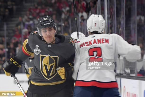 Matt Niskanen of the Washington Capitals is checked into the boards by Tomas Nosek of the Vegas Golden Knights during the first period in Game Five...