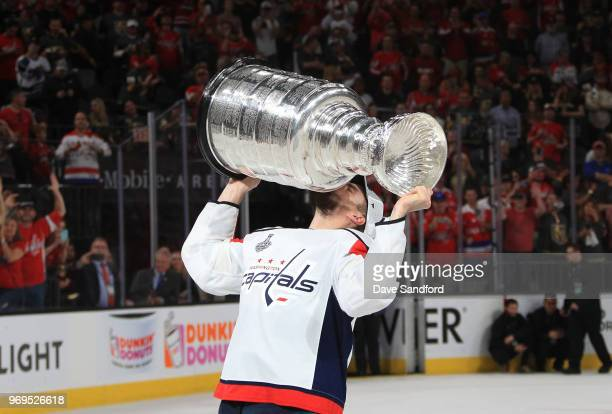 Matt Niskanen of the Washington Capitals kisses the Stanley Cup after Game Five of the 2018 NHL Stanley Cup Final between the Washington Capitals and...