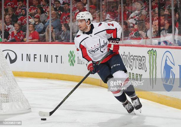 Matt Niskanen of the Washington Capitals plays the puck against the New Jersey Devils during the game at Prudential Center on October 11 2018 in...