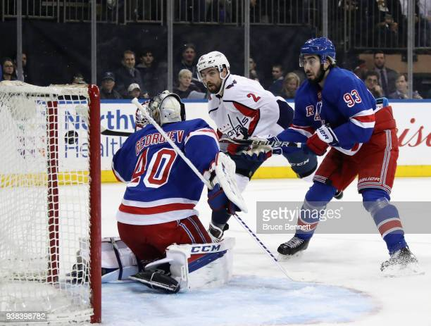 Matt Niskanen of the Washington Capitals scores at 513 of the first period against Alexandar Georgiev of the New York Rangers at Madison Square...