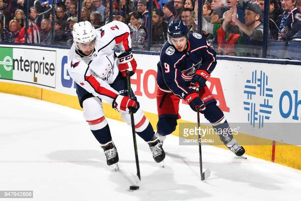Matt Niskanen of the Washington Capitals skates with the puck as Artemi Panarin of the Columbus Blue Jackets defends during the third period in Game...