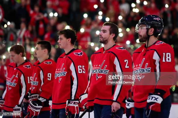 Matt Niskanen of the Washington Capitals stands on the ice with his teammates and the Detroit Red Wings for a NHLwide moment of silence for Hockey...