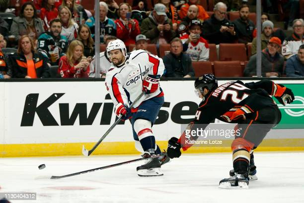 Matt Niskanen of the Washington Capitals takes a shot on goal as Carter Rowney of the Anaheim Ducks looks to block during the second period at Honda...