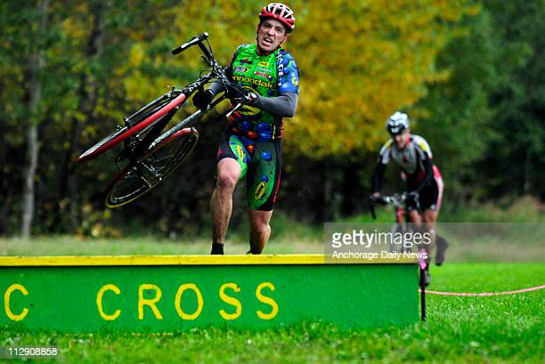 Matt Novakovich jumps the obstacles on one of the final laps on the cyclocross course at Russian Jack Springs Park on September 17, 2008. Novakovich...