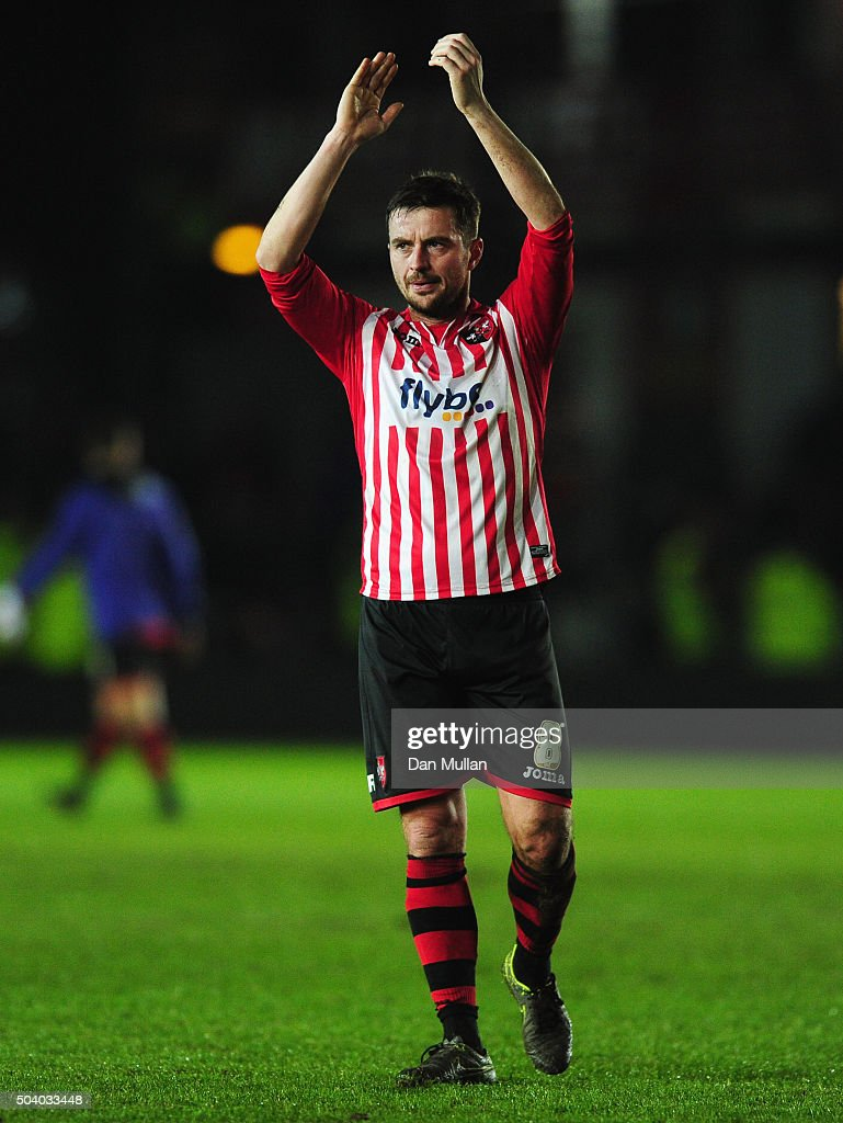 Matt Oakley of Exeter City applauds the crowd as they draw after the Emirates FA Cup third round match between Exeter City and Liverpool at St James Park on January 8, 2016 in Exeter, England.