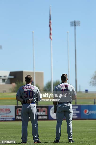 Matt Oberste and Tim Tebow of the Scottsdale Scorpions stand for the national anthem before the Arizona Fall League game against the Peoria Javelinas...