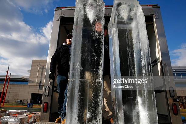 Matt O'Brien of Salem Mass unloads ice that will be used to create a winter display on the Lawn on D called 'Fire Ice' in South Boston on December 31...