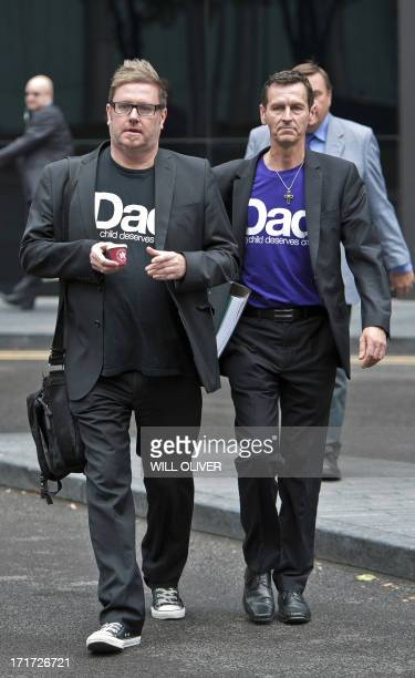Matt O'Conner the founder of Fathers for Justice and Tim Haries who is accused of defacing a portrait of Queen Elizabeth II arrive at the Southwark...
