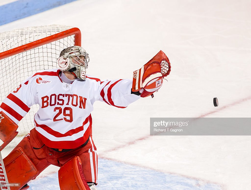 Matt O'Connor #29 of the Boston University Terriers misses the puck during NCAA hockey against the Boston College Eagles at Agganis Arena on January 16, 2015 in Boston, Massachusetts.
