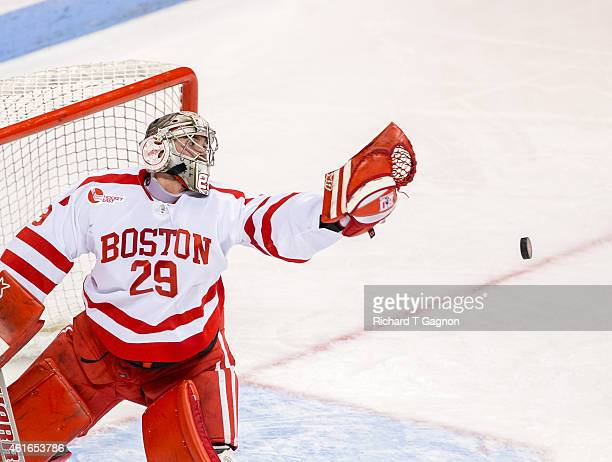 Matt O'Connor of the Boston University Terriers misses the puck during NCAA hockey against the Boston College Eagles at Agganis Arena on January 16...