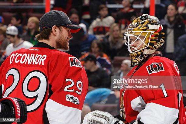 Matt O'Connor of the Ottawa Senators celebrates with team mate Mike Condon their win against the Edmonton Oilers at Canadian Tire Centre on January 8...