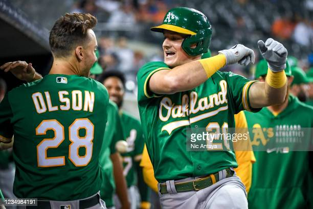 Matt Olson and Matt Chapman of the Oakland Athletics celebrate in the dugout after Chapman hit a solo home run during the top of the ninth inning at...