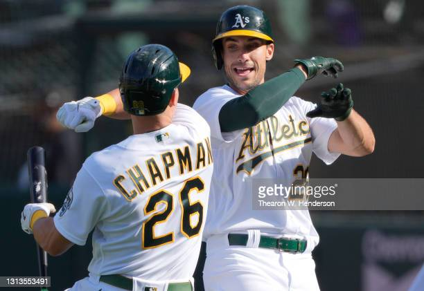 Matt Olson and Matt Chapman of the Oakland Athletics celebrates after Olson hit a grand slam home run against the Minnesota Twins in the fourth...