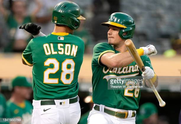 Matt Olson and Matt Chapman of the Oakland Athletics celebrates after Olson hit a solo home run against the Seattle Mariners in the bottom of the...