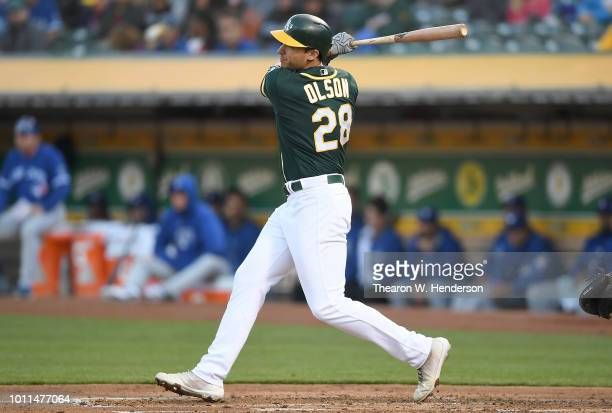 Matt Olson of the Oakland Athletics bats against the Toronto Blue Jays in the bottom of the first inning at Oakland Alameda Coliseum on July 31 2018...