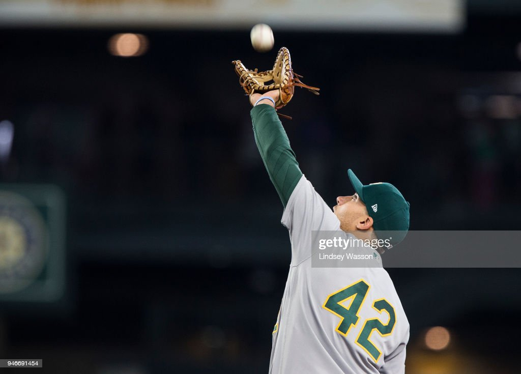 Matt Olson #28 of the Oakland Athletics catches a pop fly from Taylor Motter #21 of the Seattle Mariners in the eighth inning at Safeco Field on April 15, 2018 in Seattle, Washington. All players are wearing #42 in honor of Jackie Robinson Day.