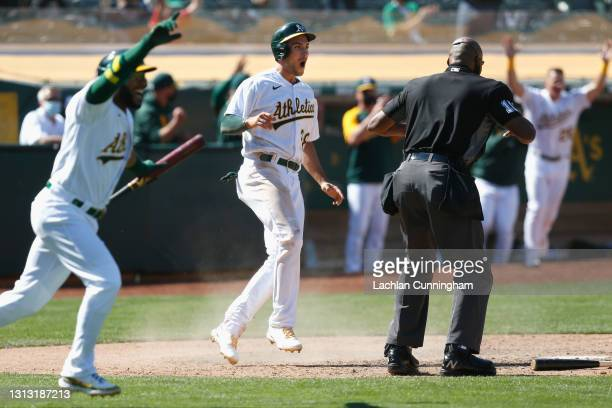 Matt Olson of the Oakland Athletics celebrates after scoring the winning run on a fielding error by Matthew Boyd of the Detroit Tigers in the bottom...
