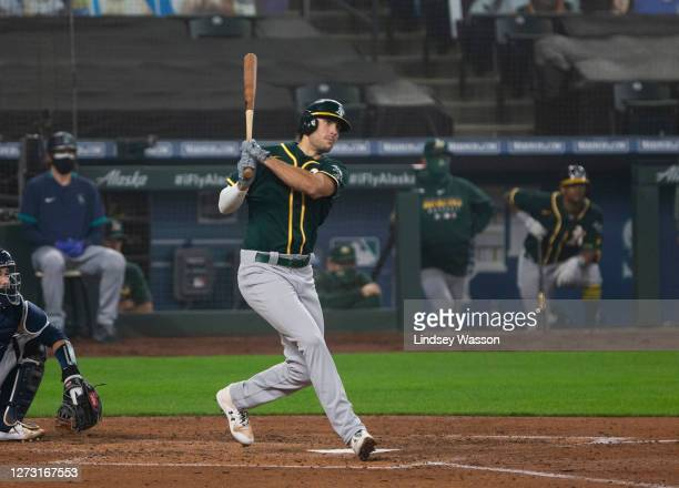 Matt Olson of the Oakland Athletics follows through during an at-bat in the fifth inning against the Seattle Mariners in the first game of a...
