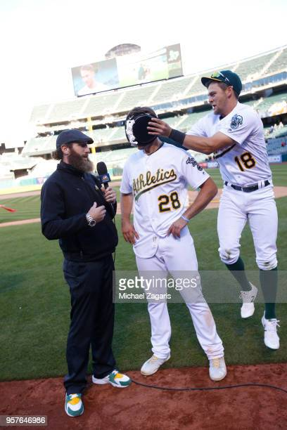Matt Olson of the Oakland Athletics gets pied by Chad Pinder while being interviewed by NBC Sports California Analyst Dallas Braden after hitting a...