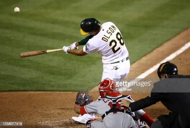 Matt Olson of the Oakland Athletics hits a grand slam home run in the tenth inning to beat the Los Angeles Angelsduring opening day at...