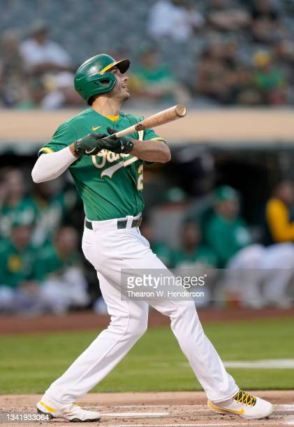 Matt Olson of the Oakland Athletics hits a solo home run against the Seattle Mariners in the bottom of the first inning at RingCentral Coliseum on...