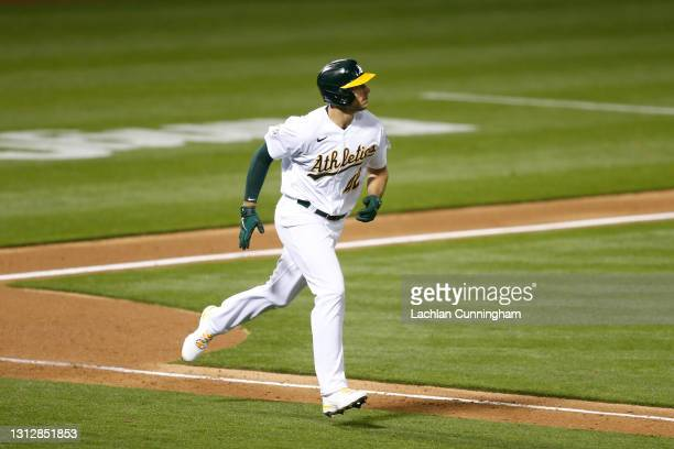 Matt Olson of the Oakland Athletics hits a solo home run in the bottom of the fifth inning against the Detroit Tigers at RingCentral Coliseum on...