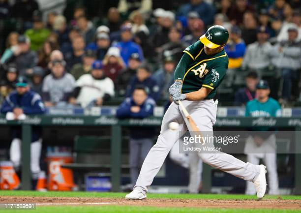 Matt Olson of the Oakland Athletics hits a two-run home run in the seventh inning to regain the lead over the Seattle Mariners at T-Mobile Park on...