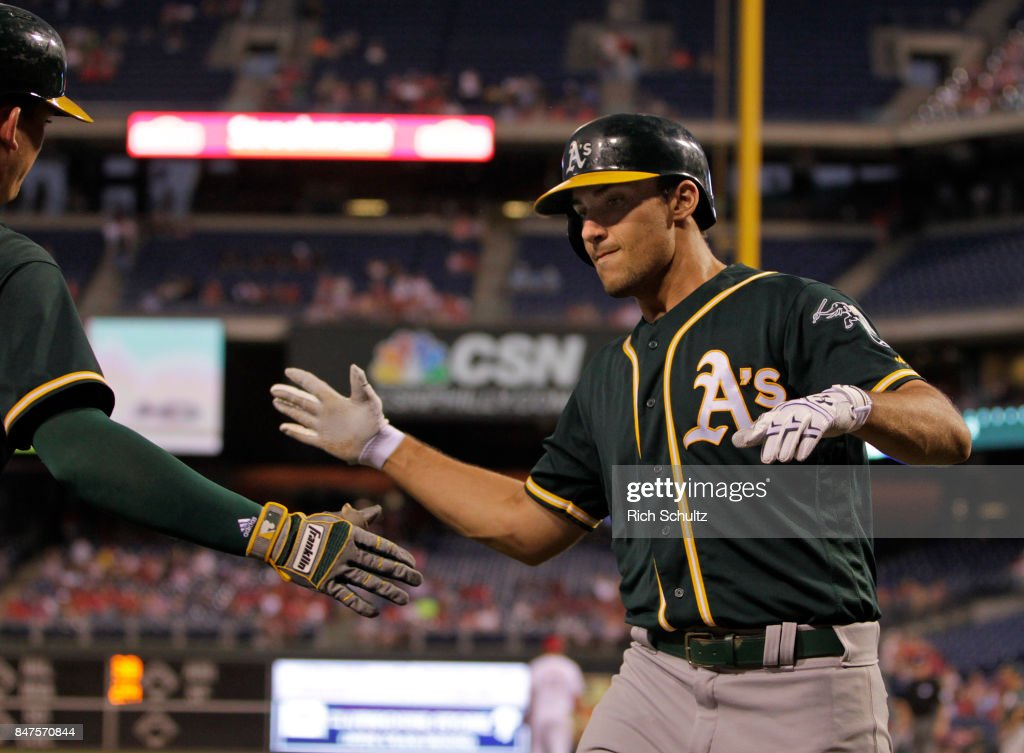 Matt Olson #28 of the Oakland Athletics is congratulated after hitting a two-run home run against the Philadelphia Phillies during the first inning of a game at Citizens Bank Park on September 15, 2017 in Philadelphia, Pennsylvania.