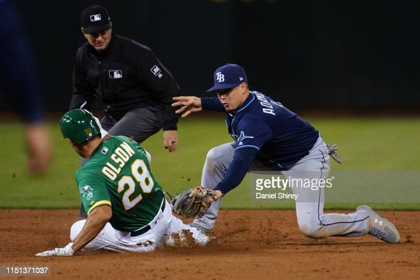 Matt Olson of the Oakland Athletics is tagged out while trying to advance to second by Willy Adames of the Tampa Bay Rays during the fifth inning at...