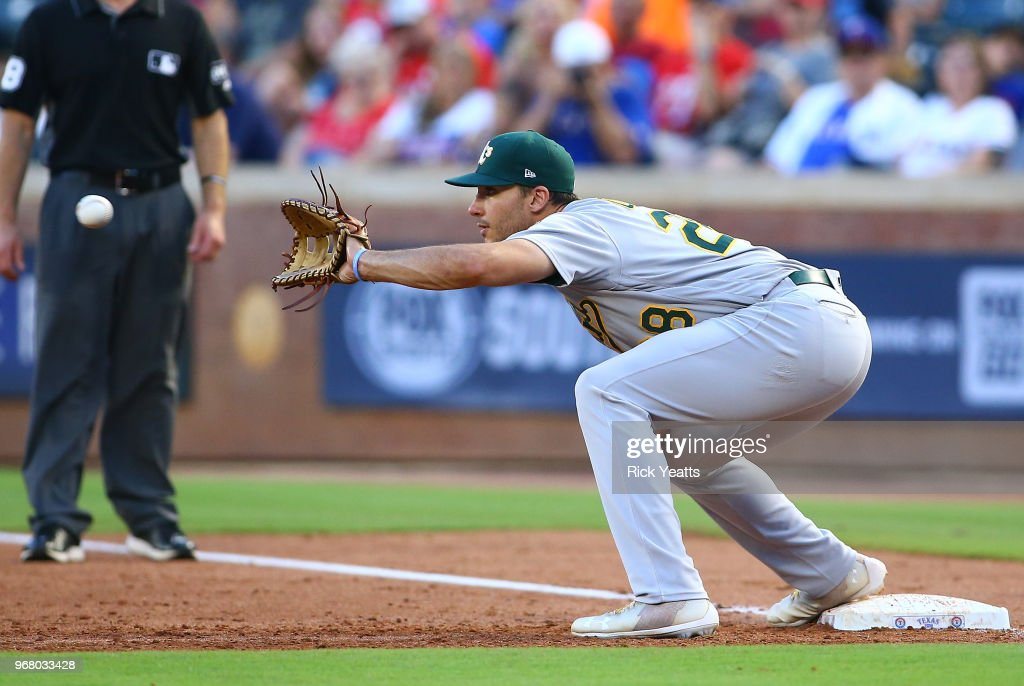 Matt Olson #28 of the Oakland Athletics makes the catch on first base in the third inning against the Texas Rangers at Globe Life Park in Arlington on June 5, 2018 in Arlington, Texas.