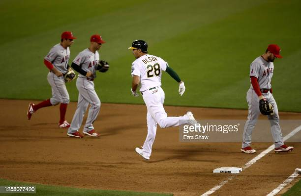 Matt Olson of the Oakland Athletics rounds the bases after he hit a grand slam home run in the tenth inning to beat the Los Angeles Angelsduring...
