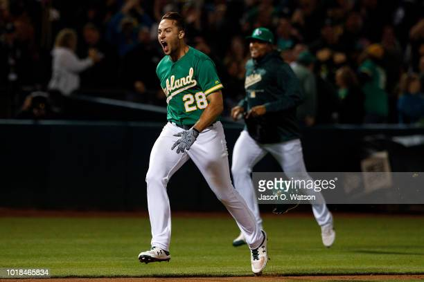 Matt Olson of the Oakland Athletics rounds the bases after hitting a walk off home run against the Houston Astros during the tenth inning at the...