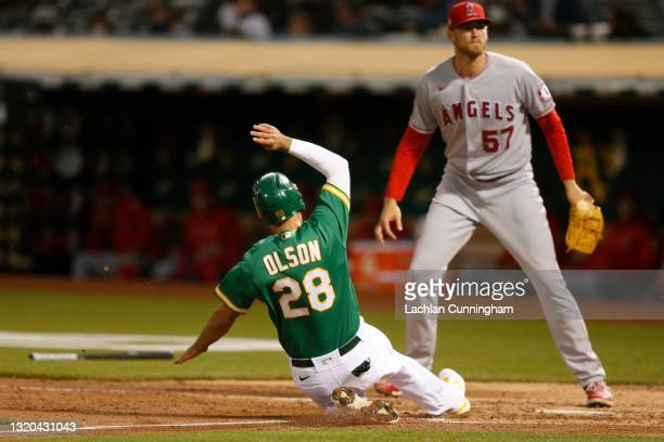 Matt Olson of the Oakland Athletics scores on a throwing error by David Fletcher of the Los Angeles Angels in the bottom of the sixth inning at...