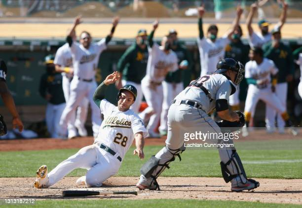 Matt Olson of the Oakland Athletics scores the winning run on a fielding error by Matthew Boyd of the Detroit Tigers in the bottom of the ninth...