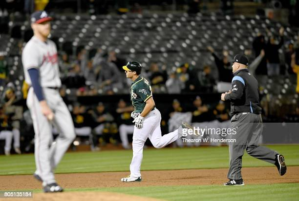 Matt Olson of the Oakland Athletics trots around the bases after hitting a solo home run off of starting pitcher Mike Foltynewicz of the Atlanta...