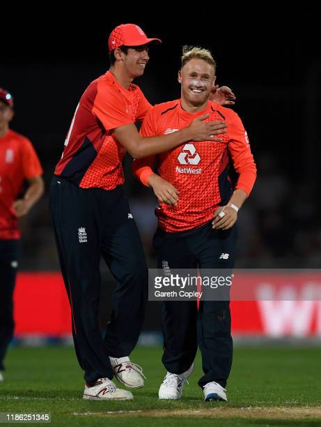 Matt Parkinson of England celebrates with Pat Brown after dismissing Daryl Mitchell of New Zealand during game four of the Twenty20 International...