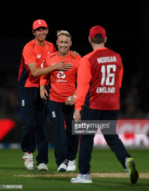 Matt Parkinson of England celebrates with Pat Brown and Eoin Morgan after dismissing Daryl Mitchell of New Zealand during game four of the Twenty20...