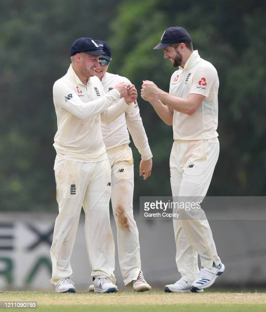 Matt Parkinson of England fist pumps with Chris Woakes after dismissing Lahiru Milantha of SLC Board President's XI during day two of the tour match...