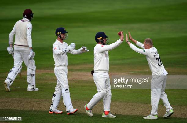 Matt Parkinson of Lancashire celebrates after dismissing Craig Overton of Somerset during Day One of the Specsavers County Championship Division One...