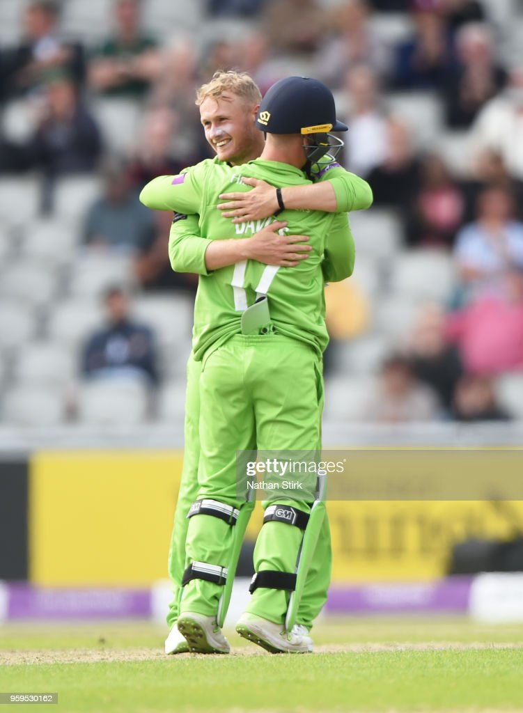Matt Parkinson of Lancashire celebrates with Alex Davies after getting a wicket during Royal London One-Day Cup match between Lancashire and Nottinghamshire at Old Trafford on May 17, 2018 in Manchester, England.