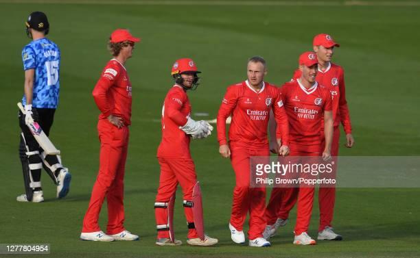 Matt Parkinson of Lancashire celebrates with team-mates Keaton Jennings, Alex Davies, Luke Wood and Tom Hartley after the dismissal of George Garton...