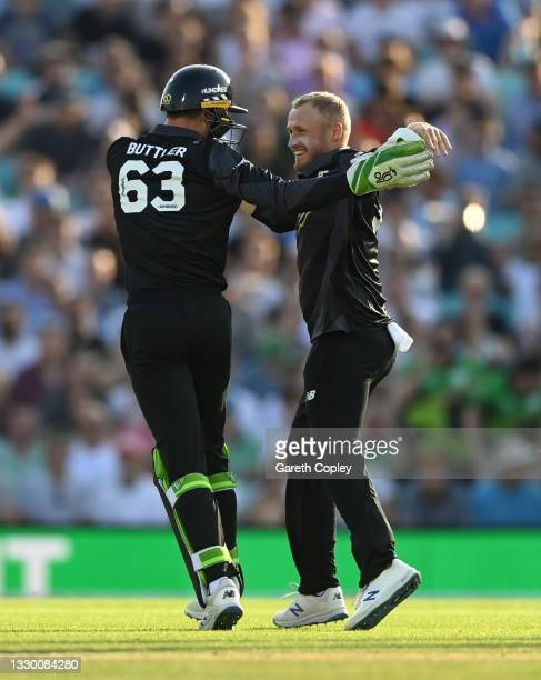 Matt Parkinson of Manchester Originals celebrates with Jos Buttler after dismissing Will Jacks of Oval Invincibles during the Hundred match between...