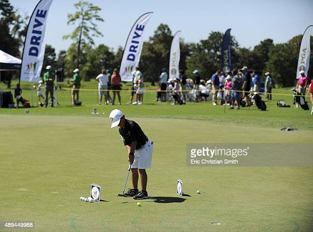 Matt Pawly putts during the Boys 79 Putt competition during a regional round of the Drive Chip and Putt Championship at the Golf Club of Houston on...