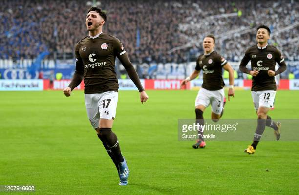 Matt Penney of FC St. Pauli celebrates after scoring his team's second goal during the Second Bundesliga match between Hamburger SV and FC St. Pauli...