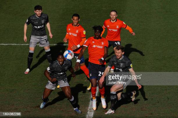 Matt Penney, Osaze Urhoghide and Tom Lees of Sheffield Wednesday compete for a cross with Thomas Ince, Elijah Adebayo and Jordan Clark of Luton Town...