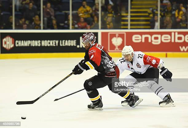 Matt Pettinger of Hamburg Freezers battles with Brandon Benedict of Nottingham Panthers during the Champions Hockey League group stage game between...