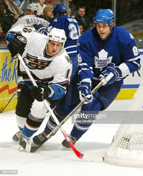Matt Pettinger of the Washington Capitals battles for position with Eric Lindros of the Toronto Maple Leafs on November 8 2005 at the Air Canada...