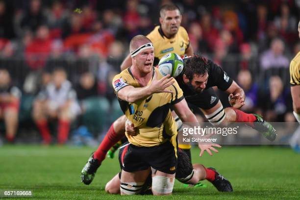 Matt Philip of the Force offloads the ball during the round five Super Rugby match between the Crusaders and the Force at AMI Stadium on March 24...