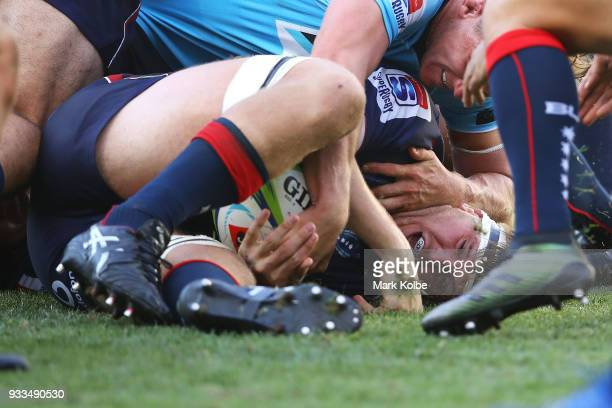 Matt Philip of the Rebels is tackled during the round five Super Rugby match between the Waratahs and the Rebels at Allianz Stadium on March 18 2018...